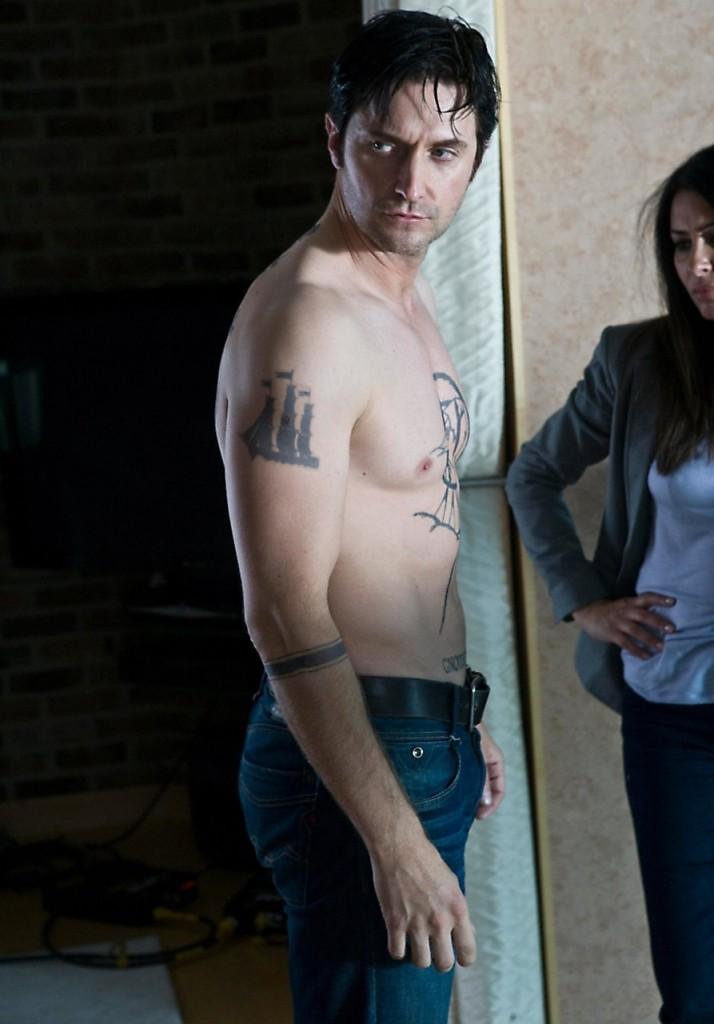 RA as Lucas festooned in tatoos